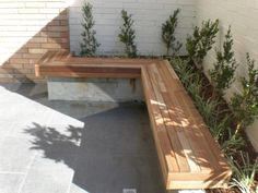 Garden bed with built in seat