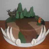 hunting themed cake...camoflauged fondant, gumpaste antlers, fondant trees and toy hunter and deer