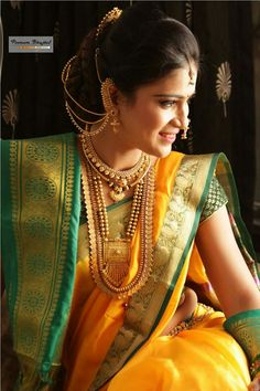 What a beautiful large low bun with ear chains! Care however should be taken bef… Indian Bridal Outfits, Indian Bridal Wear, Bridal Dresses, Indian Wedding Bride, Saree Wedding, Wedding Album, Marathi Bride, Marathi Wedding, Marathi Saree
