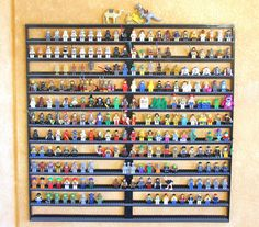 """I didn't think my minifigures were getting the attention they deserved sitting in a box, and it was hard for the kids to find their favorites to play with.  My solution was to prototype and build my own wall-mounted display case.  It's 31"""" x 31"""" in size, holds 300 minifigures, and, at 1,515 pieces, weighs 6 pounds empty.   I envision this to be dynamic artwork, showing the 300 most interesting figures at any given time. I didn't want to enclose the display so that the kids could have easy…"""