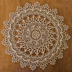 """""""Irene""""  from Leisure Arts """"Doilies With A Twist""""  by Patricia Kristoffersen     DMC Cebelia Crochet Cotton, Size 10  color: #437 Camel     12-1/2 inches using a size 5 (1.90mm) steel hook"""