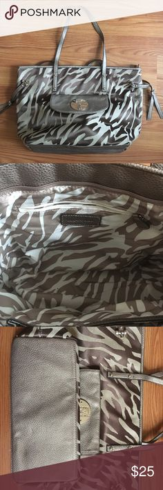 """ANNE KLEIN BROWN ZEBRA PRINT TOTE BAG NWOT CANVAS BROWN ZEBRA-LIKE PRINT WITH SILVER HARDWARE, ZIP CLOSURE. 2 OPEN INTERIOR POCKETS AND ADDITIONAL ZIP POCKET. BACK EXTERIOR POCKET AND SNAP FRONT POCKET. MEASURES: 18"""" ACROSS, 11"""" LENGTH, 5.5"""" WIDE. NEW WITHOUT TAGS. Anne Klein Bags Totes"""
