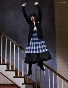 She's no Mary Poppins but she flies and rocks a plaid skirt in Beetlejuice
