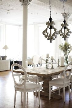 This item qualifies for Free Shipping! In Stock. No Backorders. Made from wood with a white painted and distressed finish, this chandelier is unique for its finish and size. There aren't many lighting