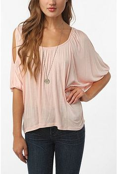 perfect casual tee, yet so gorgeous and interesting.     UrbanOutfitters.com > Daydreamer LA Cold Shoulder Oversized Tee