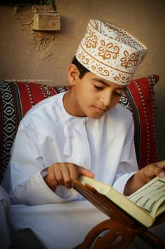 Studying the Holy Quran - Oman