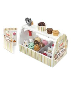 Featuring eight colorful ice cream scoop flavors and a scooper toy, this play set gives little ones everything they need to serve up fun play ice cream treats.Includes eight scoops, six toppings, two cones, plastic cup, ice cream scooper and spoon13.6'' W x 8.6'' H x 7.7'' DWoodRecommended for ages 3 years and upImported