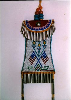 By Jim Lenoch - Kiowa style strike-a- lite Brick stitched main body , 13 cuts and reproduction beads