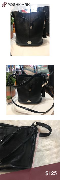RL black bucket bag This is a great bag.  Very open so you can see everything in it.  It was always my go to bag.  EUC.  No damages.  Holds up very well.  Inside pockets. Two different length straps.  Both will actually fit over the shoulder. Ralph Lauren Bags Shoulder Bags