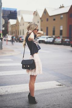 edgy shirt with girly skirt.