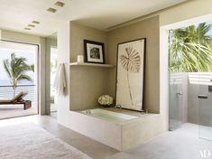 The master bath in Cindy Crawford and Rande Gerber's Mexican home has a stone tub by Legorreta + Legorreta, who also designed the entire home.