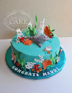 A Manatee & sea life graduation cake for a future marine biologist by Kim Does Cake -Grove city, Ohio For more information contact me at kimgifford@yahoo.com