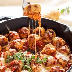 Meatballs stuffed with mozzarella and simmered in marinara sauce. An easy one pan meal!