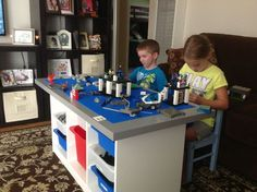 Lego Table made from Ikea $150.00 I purchased the Trofast white unit for 39.99, the gray table top for 15.99 and 14 different sized storage bins that totaled $31. Then off to the Lego store to purchase 8 plates that are 10inches, they were $4.99 so just under $40.00 and glue. The glue I used for the plates was, Loctile PL Premium Construction Adhesive. 24 1-1/4 wood nails drilled in through the underside of the storage unit into the table top.