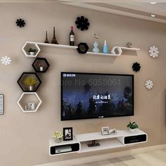 The tv cabinet set top box wall shelf space shelf creative grid wall decoration wall decoration. Tv Unit Decor, Tv Wall Decor, Wall Tv, Tv Wall Shelves, Creative Wall Decor, Creative Walls, Modern Tv Room, Modern Tv Wall Units, Modern Living