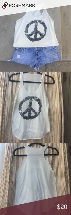 Peace Sign Racerback Tank ✌️ Women's Racerback tank. No size tag (bought at a boutique) But fits like a small. 100% cotton. Off white with peace sign in black. Measures 25 inches long and 18 inches from armpit to armpit. Super comfy and cute for a beach day or concert! Denim shorts not included. ✌️ Tops Tank Tops