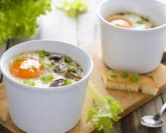 Baked Eggs In Mushroom Sauce - These little individual breakfast casseroles are too cute, and mighty tasty too. Baking eggs in a creamy, savory mushroom sauce is a refreshing break from omelets and scrambled eggs. Quick Recipes, Egg Recipes, Sauce Recipes, Stuffed Mushrooms, Stuffed Peppers, Tasty, Yummy Food, Mushroom Sauce, Baked Eggs
