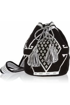 WAYÚU TAYA Mochilla hand-woven cotton shoulder bag Hand-woven Black, white and pale-green cotton Shoulder strap Designer-stamped wooden disc Tasseled drawstring fastening at top Designer color: Black/ White/ Gray Each bag is handmade and totally unique.