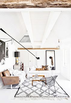 White living room with exposed ceiling beams
