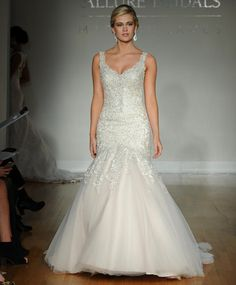 Allure fall 2016 wedding gown with sparkling beaded details on straps and bodice with a tulle fit and flare skirt