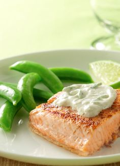 Salmon with Creamy Lime Sauce....this salmon dish can be made in only 20 minutes and is less than 300 calories per serving; the salmon will stand out with a sour cream lime sauce and can be made for just 2 people or the entire family!
