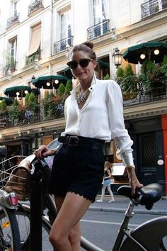scalloped edge shorts, top knot, classic white blouse, & statement necklace