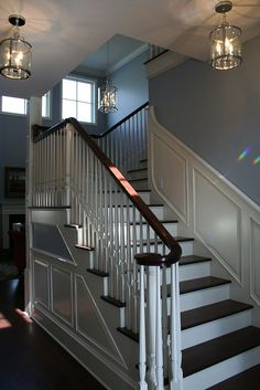 I love black stairs with white rises; although I think I would like black balusters/spindles better. Lovely!
