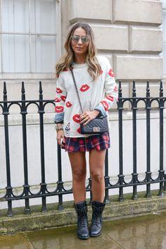 The 20 Best Street Style Looks from London Fashion Week, Fall 2014: Lala Noleto (Chanel bag and boots, Studio 24 skirt, Juliana Manzini jewellery, Dianes Beachwear sweater, Ventura sunglasses, a Gap shirt)