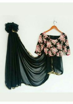 Floral print blouse with plain black saree with gold border