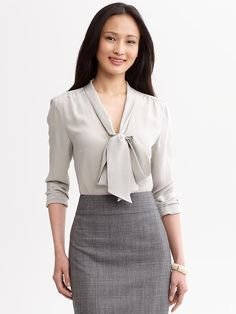So happy I work in a job where I don't have to dress like this. Have I told you how much I hate pussy-bow blouses? Yeah, I think I have...