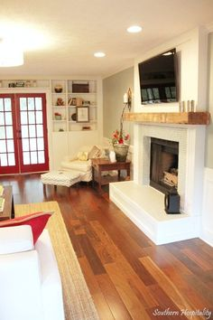 bookcases on window wall & fireplace wall with tv