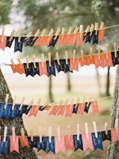 pennant flag seating cards | Photography by ryanrayphoto.com, Floral and Design by http://mijanne.co  Read more - http://www.stylemepretty.com/2013/08/26/florida-wedding-from-ryan-ray-photography/
