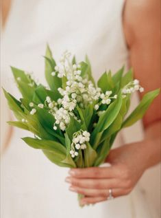 A fresh, simple bunch of lily of the valley makes a quietly beautiful bridal bouquet.