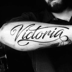 Black ink script font guys victoria name forearm tattoo Forearm Name Tattoos, Last Name Tattoos, Tattoo Name Fonts, Names Tattoos For Men, Hand Tattoos, Tattoo Font For Men, Tattoo Lettering Styles, Cursive Tattoos, Tattoos Arm Mann