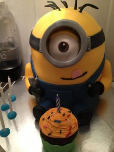 amazing minion cake.  Cute for a birthday party. I think Corbin would freak out if he saw us cutting up the minion lol