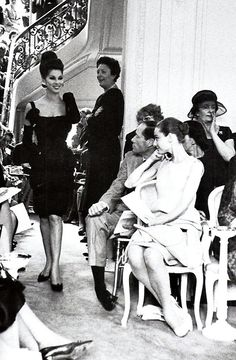 Audrey and her husband at a fashion show. Look at her sitting like the perfect lady she was