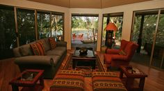 Lounge and dining area leading onto the main deck on the Mambova Rapids