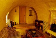 A unique cave hotel in Uchisar, Cappadocia. More photos of the decor are here http://turkishtravelblog.com/cave-hotel-cappadocia-uchisar-taskonakla/