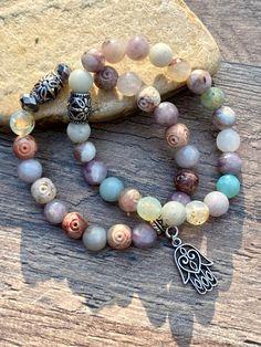 Spiritual Hamsa Hand Bracelet paired with the Pastel Bracelet for a perfect stack 🍭💟🌸 #hamsa #hamsahand #pastel #jewelry #diyjewelrymaking #bracelet #bohojewelry #handmadejewelrydiy Boho Jewelry, Unique Jewelry, Hand Bracelet, Hamsa Hand, Diy Jewelry Making, Spiritual, Etsy Seller, Pastel, Bohemian