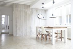 Reclaimed scaffolding planks with a lime wash are used to panel the wall