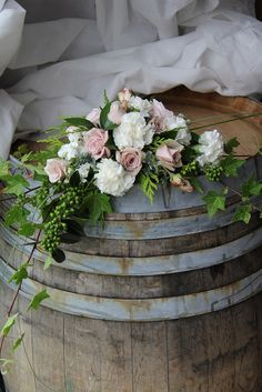 Old barrels and fresh beautiful flowers for this outdoor wedding in Wanaka, New Zealand from Unique Flowers, Beautiful Flowers, Destination Wedding, Wedding Venues, Table Signs, Barrels, Bouquets, Wedding Flowers, Floral Wreath