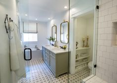 I like the pewter sink fixtures and the cabinet.  I like the mirrors too but don't know if I'm willing to give up medicine cabinets. I like the storage in the toilet area too. And the tile on the floor.