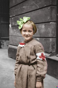 Young girl acting as a nurse during the Warsaw Uprising, 1944.