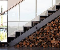 "Firewood stacked under stairs? ""30 Interiors Decorated With Firewood 