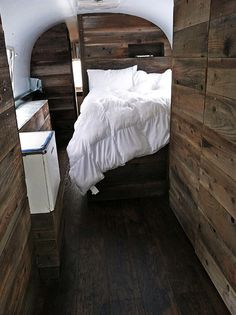 An Airstream with  rustic wood walls, Amazing!