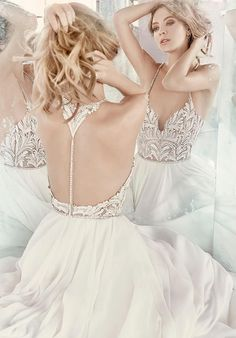 Ivory chiffon A-line gown, celestial beaded bodice with V-neckline and T-strap back, full circular chiffon skirt.