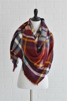 Blanket scarf is barn red, mustard, and navy plaid