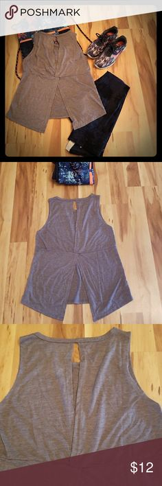 Balance Collection Active Grey Tank M NWOT Simple and trendy sleeveless tank top with rounded neck, cut out in back, on top and split bottom half. Loose fitting and comfortable. Great for a workout or running errands. Perfect athleisure wear top. SIZE MEDIUM. Balance Collection Tops Tank Tops