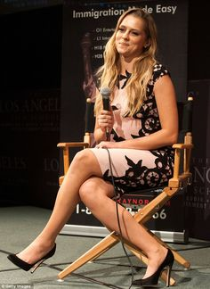 Forget warm, she's got a hot body! Teresa Palmer draws attention to her derriere in tight shift dress at film screening
