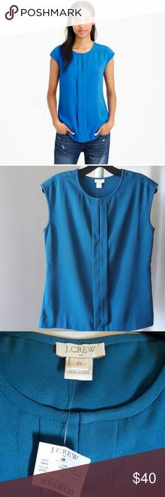 J CREW BLOUSE This beautiful teal top is both comfortable and stylish! Great to wear dressed up with a blazer or on its own. 100% polyester.  (It photographs blue for some reason, but trust me, it's a pretty teal green). J. Crew Tops Blouses